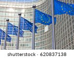 Small photo of BRUSSELS, BELGIUM - JUL 30, 2014: Flags in front of the EU Commission building in Brussels.