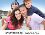 parents doing piggyback to... | Shutterstock . vector #62083717