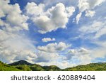 white fluffy clouds in the blue ... | Shutterstock . vector #620889404