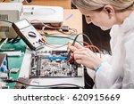 young woman repairing computer... | Shutterstock . vector #620915669
