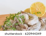 frozen raw shrimp with tails on ... | Shutterstock . vector #620944349