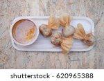 oriental fried wonton filled... | Shutterstock . vector #620965388