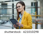 business woman using a tablet... | Shutterstock . vector #621010298