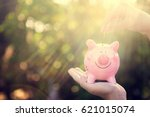 saving money woman hands... | Shutterstock . vector #621015074