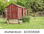 Abandoned Red Shack With Brown...