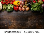 fresh raw vegetables on wooden... | Shutterstock . vector #621019703