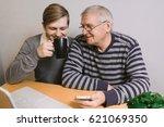 grandson grandfather teaches... | Shutterstock . vector #621069350