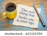 Small photo of The only thing that limits you is your ego - handwriting on a napkin with a cup of espresso coffee