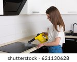young beautiful woman cleaning... | Shutterstock . vector #621130628
