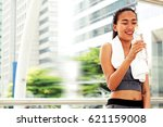 sporty woman is holding a... | Shutterstock . vector #621159008