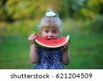 girl eats watermelon | Shutterstock . vector #621204509