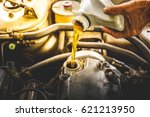 car mechanic replacing and... | Shutterstock . vector #621213950