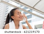 woman is cooling down the heat... | Shutterstock . vector #621219170