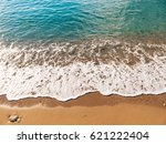 sandy beach and waves  close up.... | Shutterstock . vector #621222404