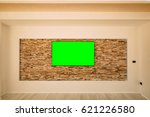 a modern lcd tv with a green... | Shutterstock . vector #621226580