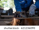 Small photo of Woker cutting metal steel plate by process oxygen and acetylene,industrial worker on manufacturing area.