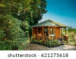 Wooden Shed House With Flowers...