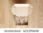 opened cardboard box with wood... | Shutterstock . vector #621290648