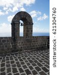Small photo of Part of Brimstone Hill Fortress wall with a bell arch, Saint Kitts and Nevis.