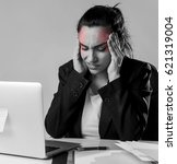 Small photo of young attractive business woman working at laptop computer office desk in stress suffering intense headache and migraine feeling overworked and overwhelmed in work crisis concept
