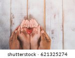 Hand Holding A Red Heart ...