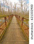 Small photo of Footbridge over a Quiet River in the Cache River Natural Area in Illinois