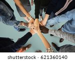 group of people holding hand... | Shutterstock . vector #621360140
