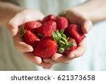 Handful Of Strawberries On Blu...