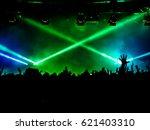 cheering crowd at a rock concert | Shutterstock . vector #621403310
