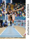 Small photo of ISTANBUL, TURKEY - JANUARY 28, 2017: Athlete Kader Gul long jumping during Turkish Athletic Federation Indoor Olympic Record Attempt Races