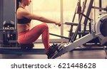 sport girl in gym using fitness ...   Shutterstock . vector #621448628