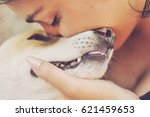 latin woman love pet dog | Shutterstock . vector #621459653