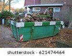 loaded dumpster near a... | Shutterstock . vector #621474464