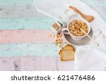 raw oatmeal in the bowl  | Shutterstock . vector #621476486