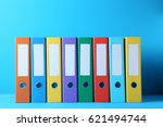 colorful office folders on blue ... | Shutterstock . vector #621494744