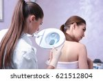 woman visiting dermatologist at ... | Shutterstock . vector #621512804