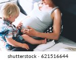 pregnant mother and son are... | Shutterstock . vector #621516644