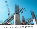 Steel Frames of A Building Under Construction, With Tower Crane On Top - stock photo