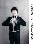 Small photo of Male comedy artist posing, circus actor