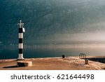 black and white lighthouse in... | Shutterstock . vector #621644498