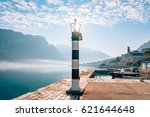 black and white lighthouse in... | Shutterstock . vector #621644648