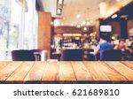 wood table top with blur coffee ... | Shutterstock . vector #621689810