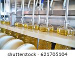 sunflower oil. factory line of... | Shutterstock . vector #621705104
