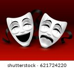 white theatrical masks on red...