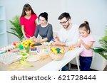 family painting eggs   Shutterstock . vector #621728444