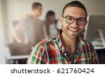 Horizontal portrait of a smiling office working man looking at camera.