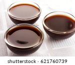 three glass bowls filled with... | Shutterstock . vector #621760739