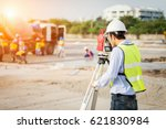 Engineer Surveyor Working With...
