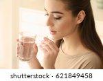 beautiful young woman taking... | Shutterstock . vector #621849458