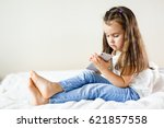 blond kid girl playing fun with ... | Shutterstock . vector #621857558